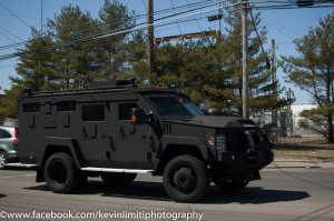 Bay Shore, NY--April 12th--An armored vehicle patrols the streets of 5th avenue before the Justice for Kenny Lazo rally and march.